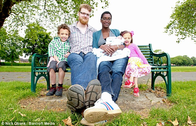 Quite a feet: The family are thought to be the biggest in the world with Keisha and Wilco measuring in at a combined 13ft 7in