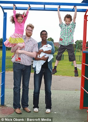 Living the high life: The couple with their 11 day old son Jonah, four-year-old Eva and Lucas, six, near their home in Dagenham