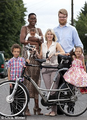 Wheely tall: The family and Kathryn Knight with one of the couple's custom made bikes