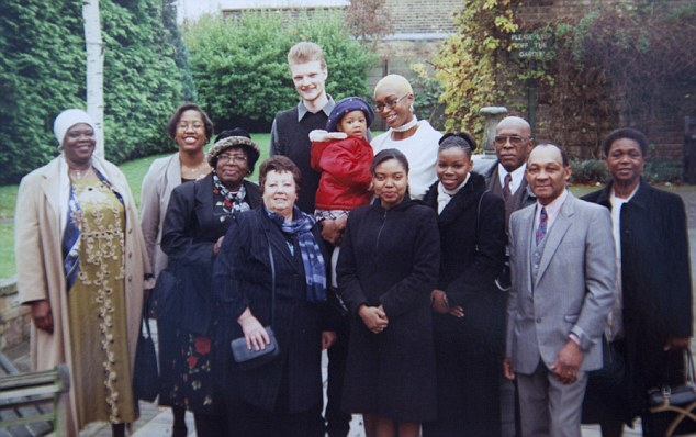 The big day: Keisha and Wilco van Kleef-Bolton with family and friends at Barking registry office on their wedding day in 2001