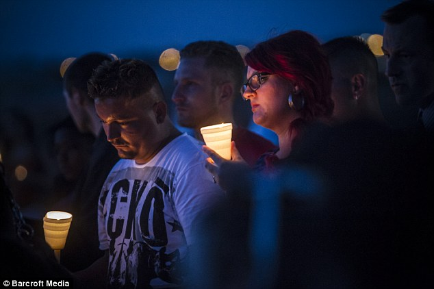 Mourners held a light vigil for the victims of multiple shooting in Aurora, Colorado