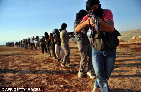 Members of Jihadist group Hamza Abdualmuttalib train near Aleppo on Thursday