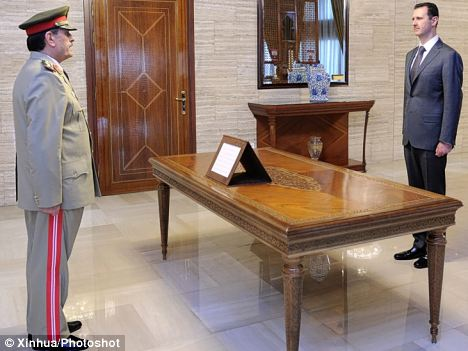 Fahad Jassim al-Freij, pictured left, was sworn in as Syria's new defense minister by Syrian President Bashar al-Assad in Damascus, capital of Syria, on Thursday