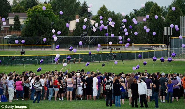 Memorial: Mourners at Gateway High School, where AJ was a student, release balloons in his honour