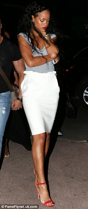 Rihanna Tries To Spare Her Dignity From The Flashing Lights As She Exits A Nightclub Daily