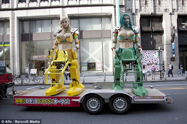 Robots on tour: A Hummer tows two robots in the streets of Shinjuku
