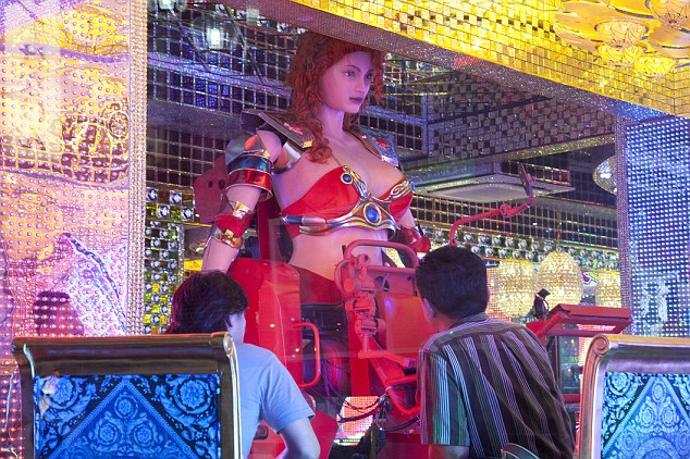 A new restaurant, advertising that it cost 10 billion yen (130 million) to open; where robots operated by real women dressed in military and other outfits, perform 'cabaret' dances for its customers, opened in the Kabukicho area, Shinjuku in Tokyo.