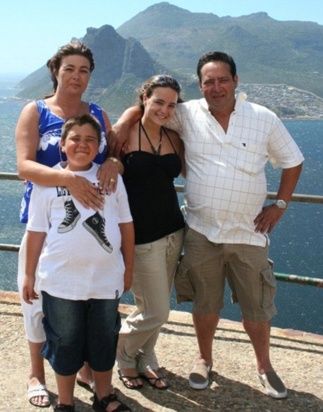 Torn apart: Amaro with his mother Geraldine and father Tony, who were shot to death by the robbers, along with Gabriela Correia, Mr Viana's daughter by his first marriage