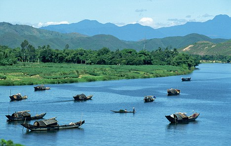 River view: The mountainous landscapes of Vietnam could make a nice change from icy Siberian winters