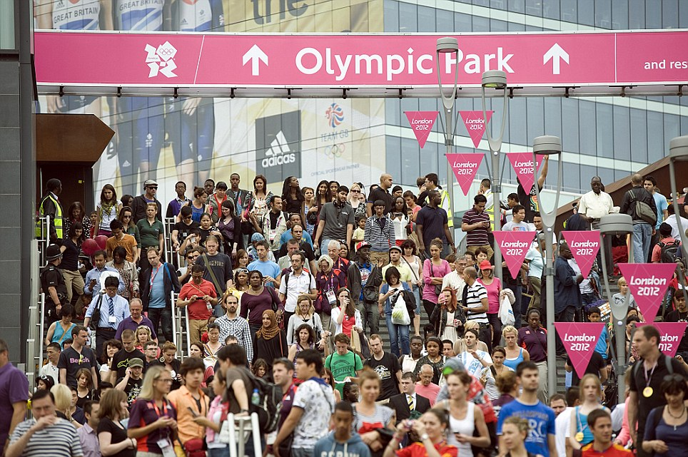 Ready, steady, go!: Crowds start to arrive in Stratford shortly after 5, ahead of the Opening Ceremony tonight