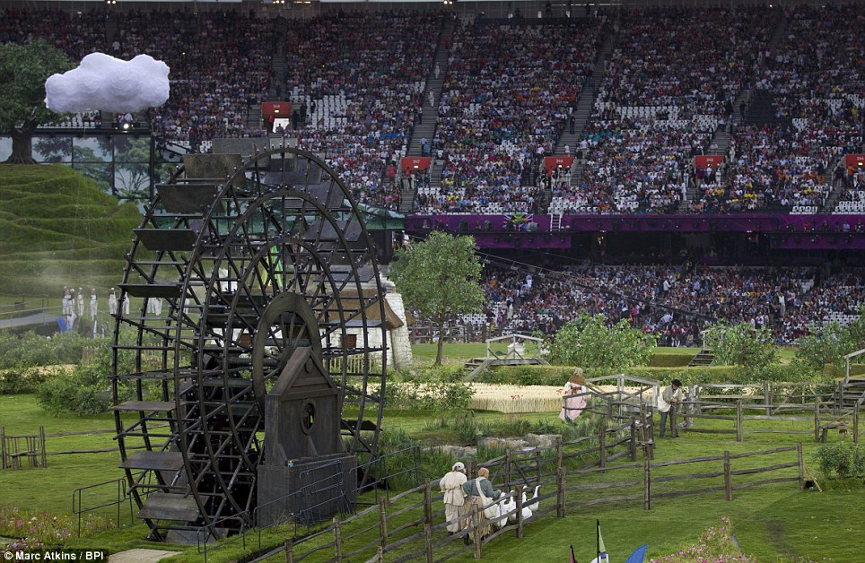 Animals, including geese take to the stage against a backdrop of artificial clouds and a giant water wheel during the opening ceremony