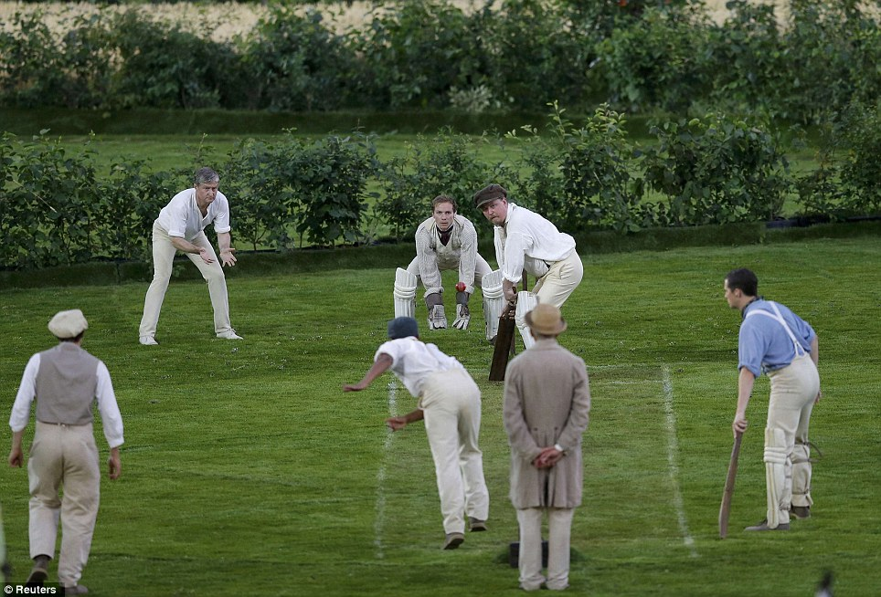 Performers play cricket during the Opening Ceremony pre-show