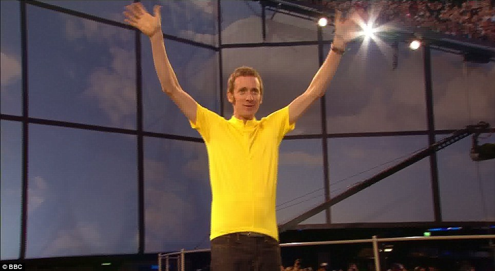 The cycling ace worse a replica of his famous Tour de France yellow jersey as he was introduced to the 70,000 strong crowd in the Olympic Stadium