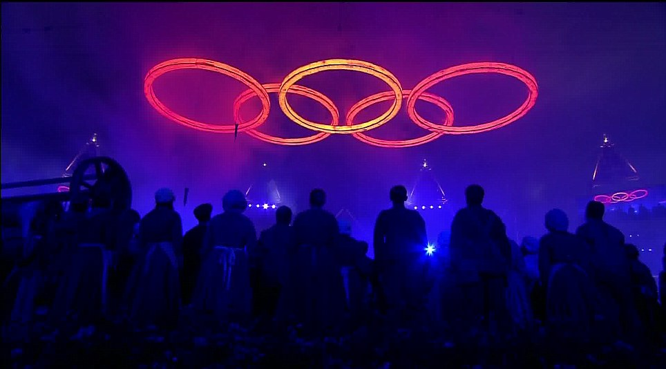 Sparks fly as the five rings are then joined to form the famous Olympic symbol