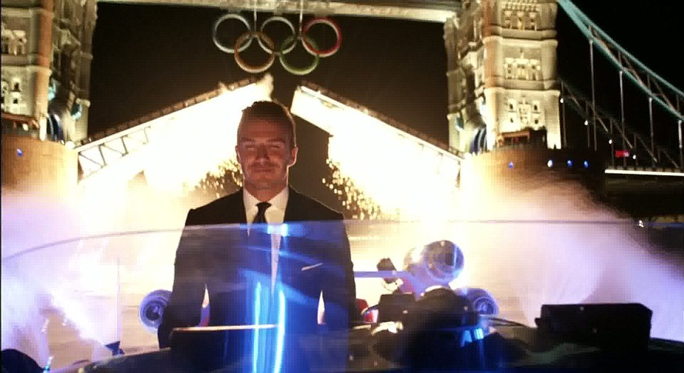 David Beckham 'drives' the torch up the River Thames in a Speedboat, past Tower Bridge