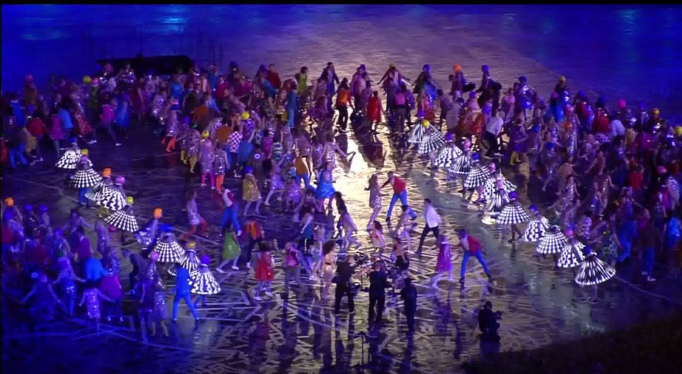 Dancing feet: A montage of songs were played as brightly-coloured dancers took to the stage