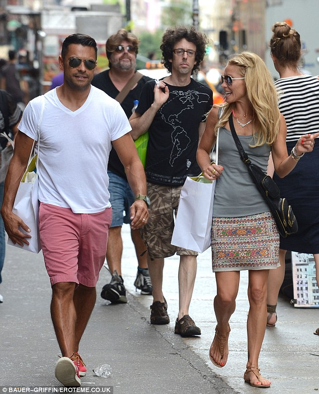 Cute couple: Actor Mark Consuelos and perky TV host wife Kelly Ripa happily shopped in New York today