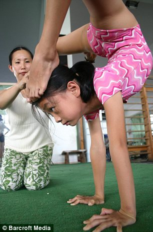 A child stretches during a gymnastics training session at Nanning Gymnasium in Nanning, China.