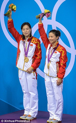 Winners: Wu Minxia (left) and her diving partner He Zi wave to spectators after receiving their medals