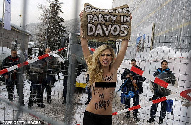 FIT UKRAINIAN BIRD WITH HER TITS OUT.Campaigner: A Femen activist demonstrates outside the annual meeting of the World Economic Forum in Davos in January