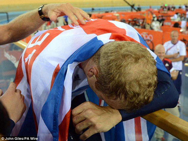 Flagging: Five-time gold medal winner Hoy, draped in the Union Jack, becomes emotional as his Olympic win sinks in