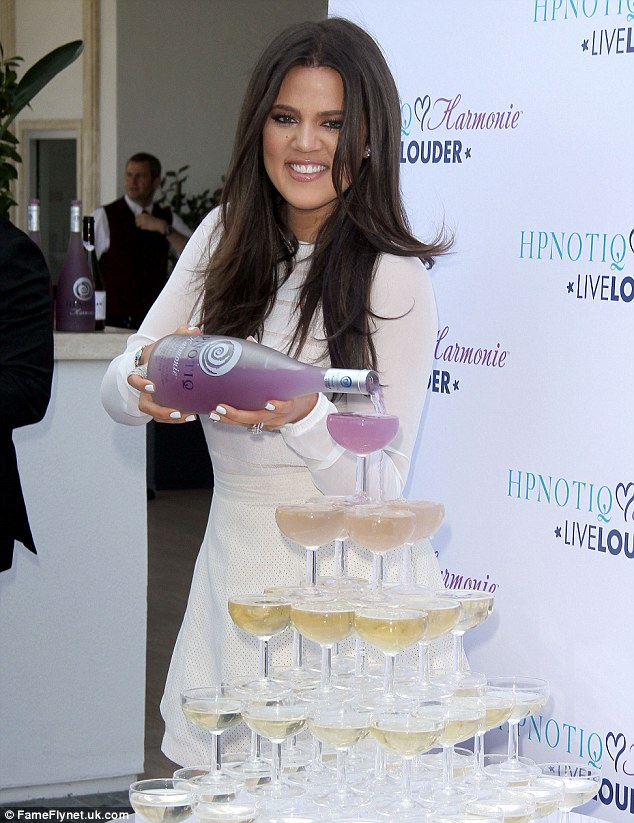 Remember to pace your self! Khloe pours the bottle over a glorious boozy fountain