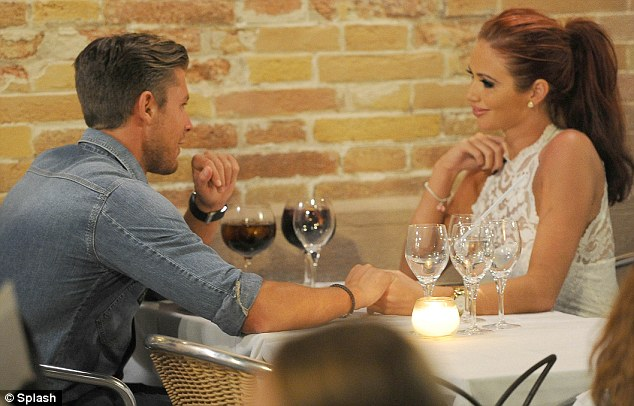 Romantic meal: Amy and David held hands across their candlelit table