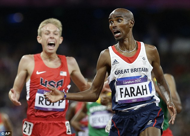Stunned: Mo Farah crosses the line to win the 10,000m title at the London Olympics