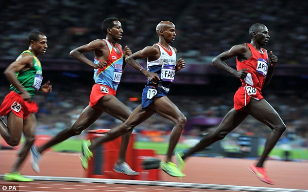 Waiting game: Farah (second right) stalks the leader as he prepares to make his move in the 10,000m