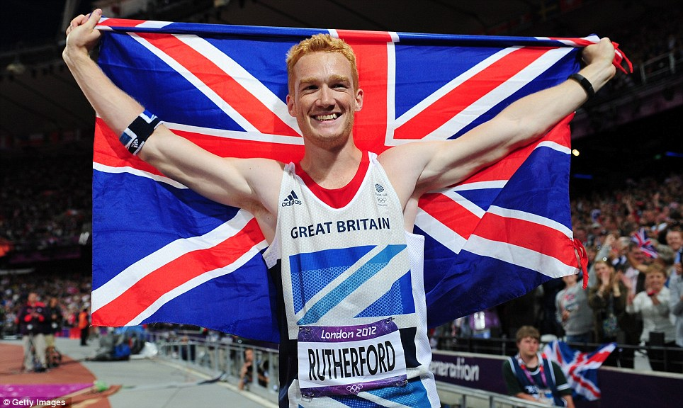 Jumping fro joy: Greg Rutherford celebrates his victory in the long jump on a remarkable evening for Team GB