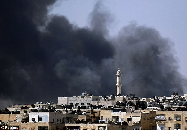 Smoke rises over the Salah al-Din neighbourhood in central Aleppo during clashes between Free Syrian Army fighters and Syrian Army soldiers yesterday
