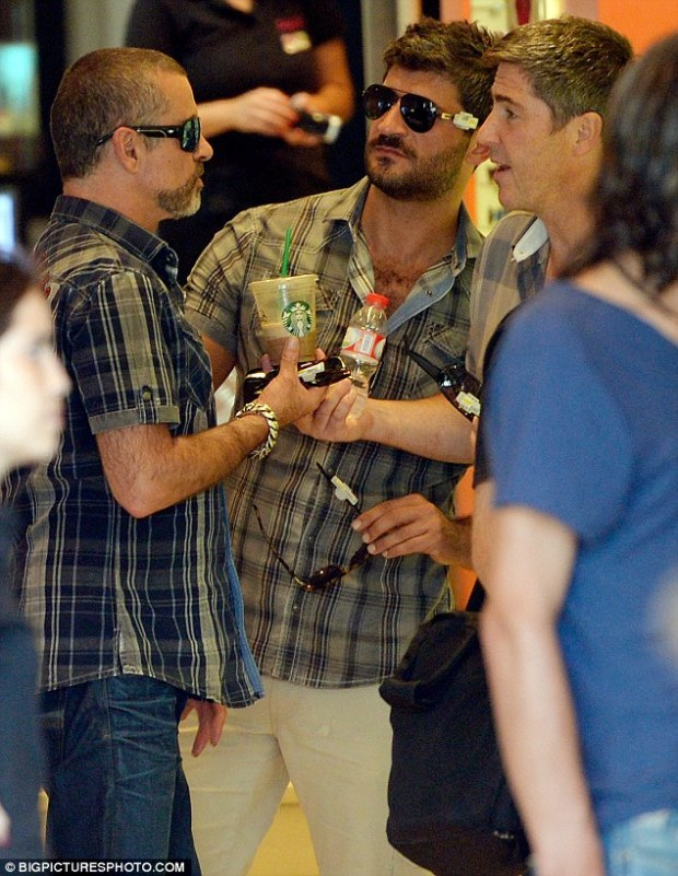 How cute: George Michael and his boyfriend Fadi Fawaz wore matching shirts as they shopped in Barcelona, Spain, earlier this week