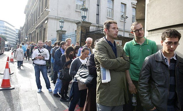 Fans queue for tickets outside the French Olympic Committee's venue on the banks of the Thames