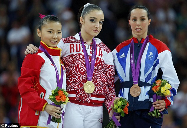 Bronze medal winner Beth Tweddle (right) pictured with Russia's Aliya Mustafina (centre) who won gold and silver medal winner He Kexin (left)