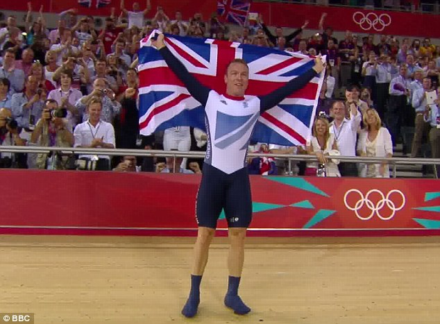 History-maker: Sir Chris Hoy holds the Union flag with pride as he celebrates winning his sixth gold medal