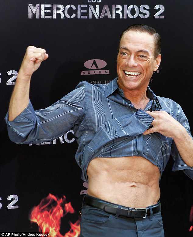 Showing off: Jean-Claude played up to the cameras as he flexed his muscles ready for the film's release later this month