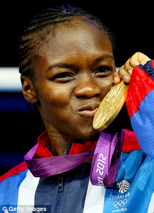 That's mine: Adams shows off her medal on the podium