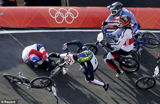 France's Joris Daudet (L on the ground) and Nicholas Long of the U.S. (64) fall