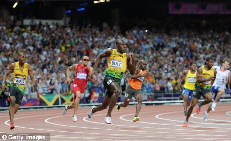 Usain Bolt (centre) of Jamaica exits the bend ahead of team mates Warren Weir (left) and Yohan Blake (right)