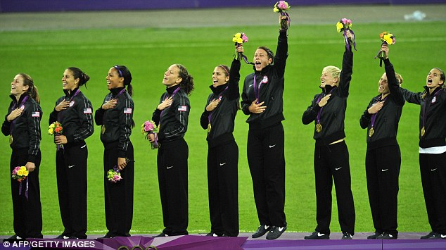 Celebrations: The women's team yell out the U.S. national anthem as they celebrate their gold medal win