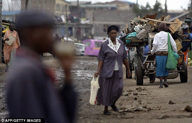 Residents of Nairobi's Huruma move along the filthy streets of the dangerous slum