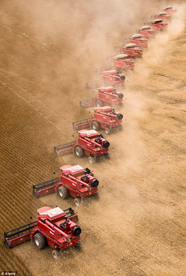 Harvest time: Huge tractors on a soya bean farm in Brazil. Farmland is now considered to be one of the best investments of our time
