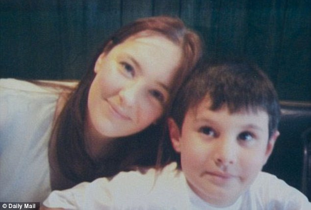 Plea: British schoolboy Adam Jones has been separated from his family in Britain after his Qatari uncle allegedly kidnapped him in 2009. He is pictured with his mother Rebecca