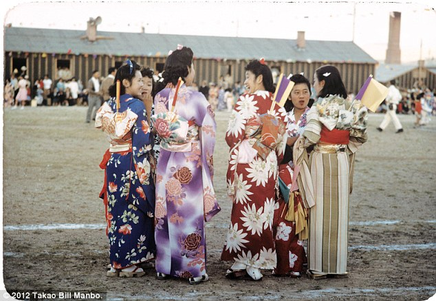 Young women chat at Bon Odori, a dance ritual performed during Obon, a summertime Buddhist festival commemorating one's ancestors. Photo by Bill Manbo