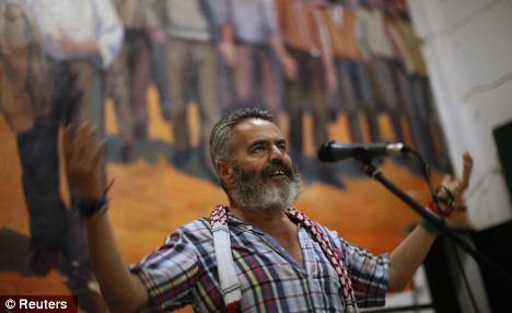 Marinaleda Mayor Juan Manuel Sanchez Gordillo, 59, gestures as he speaks during a popular assembly in Marinaleda, southern Spain