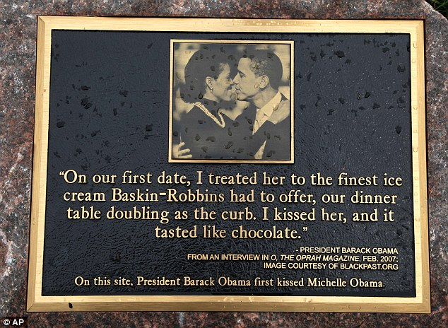 Kissing plaque: A 3,000-pound granite marker, pictured, was erected to commemorate the where the President first kissed Michele Obama