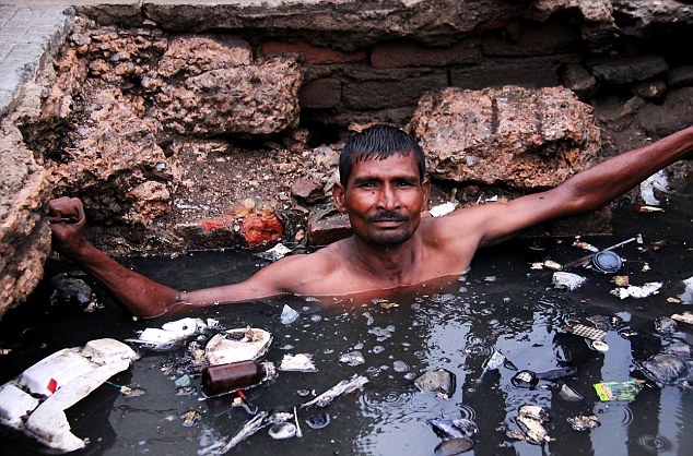 Scandalously City bosses do not provide protective clothing and Devi Lal, 43, is forced to work in hjust a pair of pants
