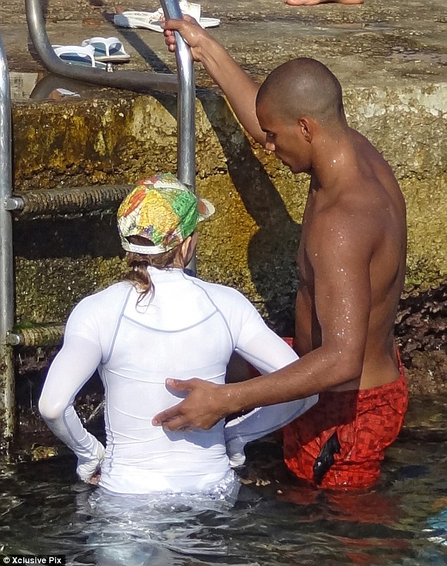 Close: Brahim took good care of his partner as he helped her climb up a ladder to exit the water
