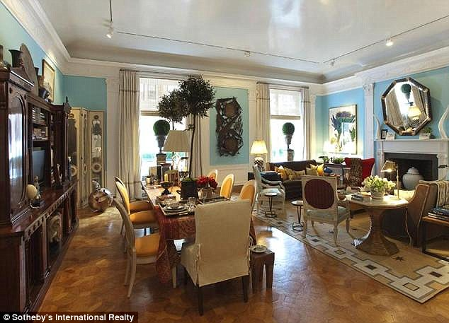 Lavish: A living room in the townhouse comes complete with a dining area