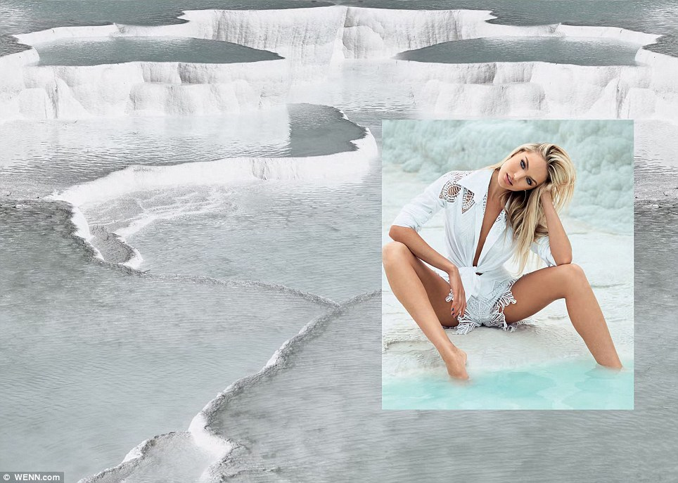 In the elements: The inset of the South African Victoria's Secret model shows her sat at the water's edge wearing some revealing bottoms with a plunging white shirt